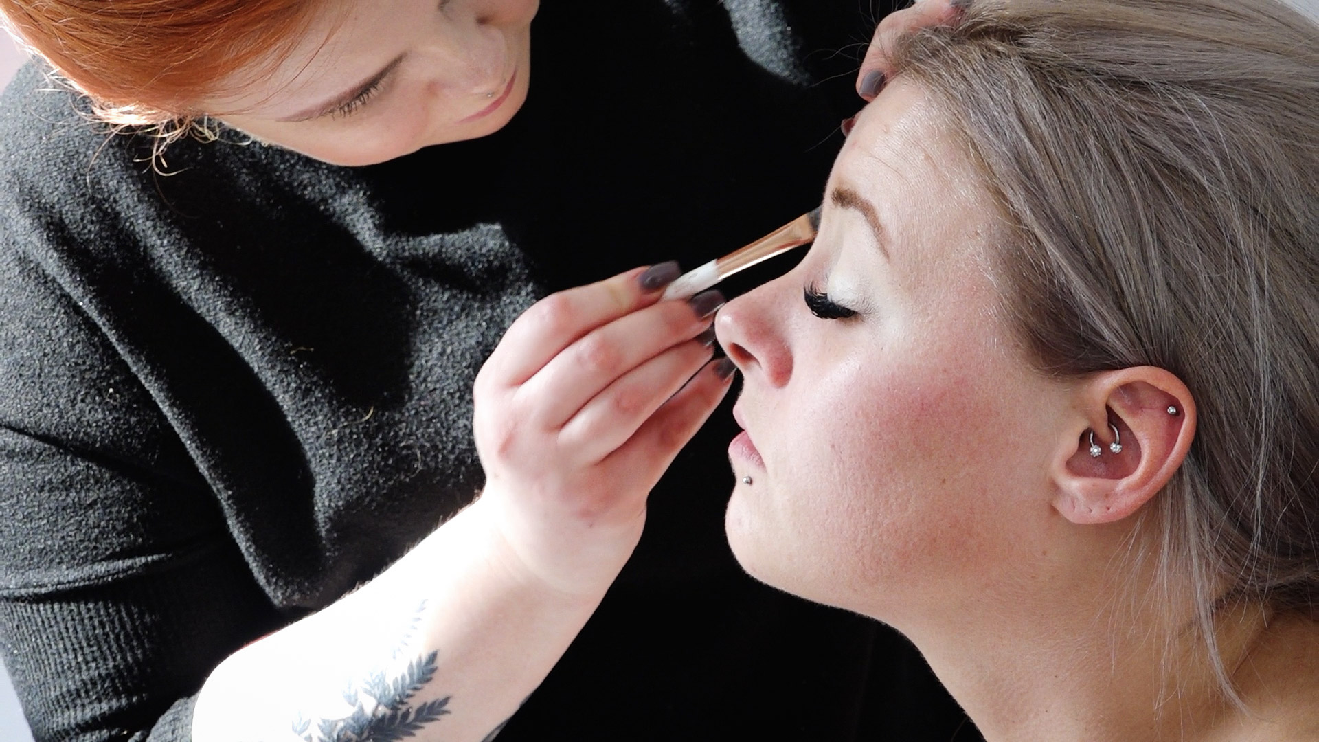 Beamish Hall wedding - the bride is having her makeup applied by a makeup artist